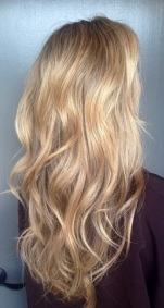 blonde hair color with glimmering gold highlights