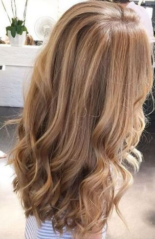 wavy hair styled using a flat iron