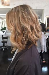 wheat blonde highlights and textured long bob hairstyle