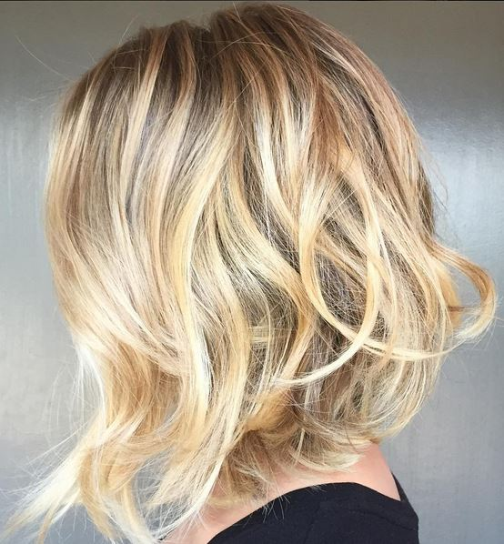 honey gold highlights and asymmetrical bob hairstyle