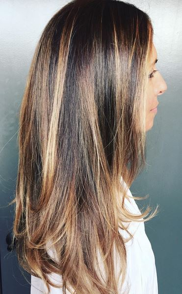 shiny brunette and caramel highlights